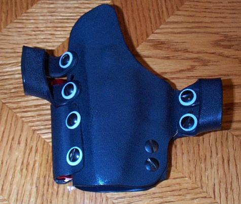 fist holster adapters includes exemplary